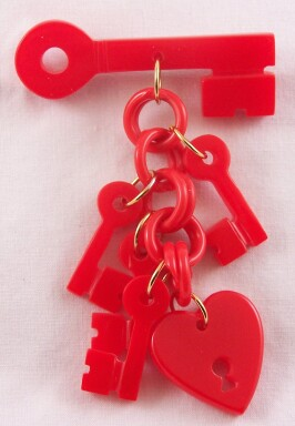 AB3 red bakelite heart/key pin