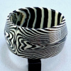 LG39 wide black/white swirled lucite saucer shaped bangle