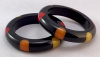 JE25 Judith Evans pr black resin bangles with 6 dots